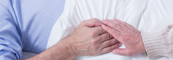 Hands of two elderly people isolated, senior couple holding each other's hands